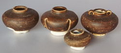 Chinese brown-glazed jarlets, height 7.5, 7.5, 4.5 and 7.5cm