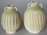 Sisatchanalai celadon jars, height 13 and 15cm